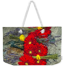 Weekender Tote Bag featuring the photograph Flowers On Rocks by Nick Zelinsky