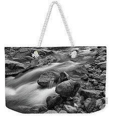 Weekender Tote Bag featuring the photograph Flowing Rocks by James BO Insogna