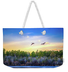 Weekender Tote Bag featuring the photograph Fly Away by Maddalena McDonald