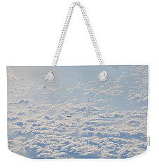 Weekender Tote Bag featuring the photograph Flying Among The Clouds by Bill Cannon