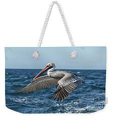 Flying Brown Pelican Weekender Tote Bag by Robert Bales