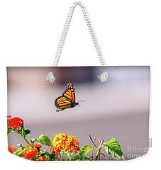 Flying Monarch Butterfly Weekender Tote Bag by Robert Bales