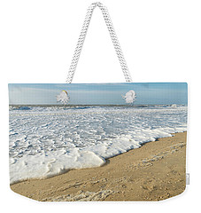 Weekender Tote Bag featuring the photograph Foam On The Waves by Hans Engbers