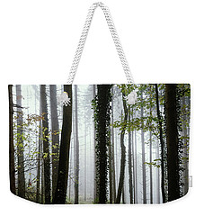 Weekender Tote Bag featuring the photograph Foggy Forest by Chevy Fleet