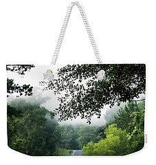 Weekender Tote Bag featuring the photograph Foggy Road To Eternity  by Shelby Young