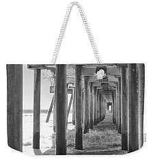 Weekender Tote Bag featuring the photograph Follow The Lines Under Huntington Beach Pier by Ana V Ramirez