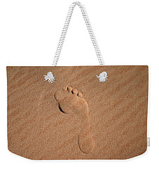 Weekender Tote Bag featuring the photograph Footprint In The Sand by Keiran Lusk