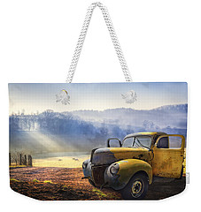 Weekender Tote Bag featuring the photograph Ford In The Fog by Debra and Dave Vanderlaan