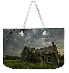 Weekender Tote Bag featuring the photograph Forgotten Mammatus  by Aaron J Groen