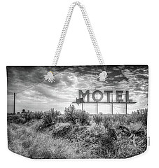 Weekender Tote Bag featuring the photograph Forgotten Motel Sign by Spencer McDonald