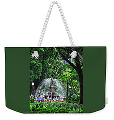 Weekender Tote Bag featuring the photograph Fountain Through The Trees By Kaye Menner by Kaye Menner