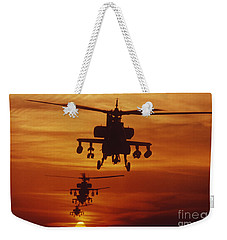 Weekender Tote Bag featuring the photograph Four Ah-64 Apache Anti-armor by Stocktrek Images