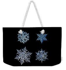 Four Snowflakes On Black Background Weekender Tote Bag