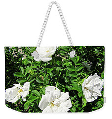 Weekender Tote Bag featuring the photograph Four White Roses by Stephanie Moore