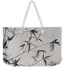 Weekender Tote Bag featuring the photograph Fragility And Strength by Linda Lees