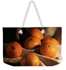 Fresh Tangerines In Brown Basket Weekender Tote Bag by Jaroslaw Blaminsky