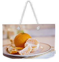 Weekender Tote Bag featuring the photograph Freshly Peeled Citrus by Cindy Garber Iverson