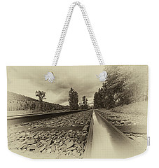 Weekender Tote Bag featuring the photograph From The Track Antique by Darcy Michaelchuk
