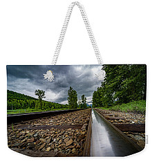 Weekender Tote Bag featuring the photograph From The Track by Darcy Michaelchuk