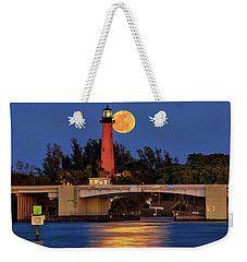 Weekender Tote Bag featuring the photograph Full Moon Over Jupiter Lighthouse, Florida by Justin Kelefas
