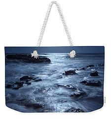 Weekender Tote Bag featuring the photograph Full Moon Rising Over Coral Cove Beach In Jupiter, Florida by Justin Kelefas