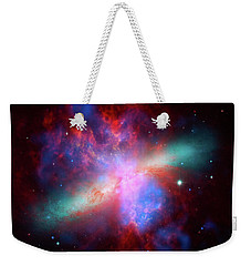 Weekender Tote Bag featuring the photograph Galaxy M82 by Marco Oliveira