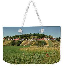 Weekender Tote Bag featuring the photograph Galgenberg Kellergasse Im Weinviertel Im Sommer by Menega Sabidussi