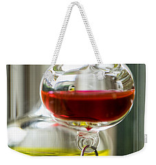 Weekender Tote Bag featuring the photograph Galileo Thermometer by Jeremy Lavender Photography