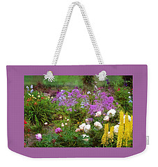 Weekender Tote Bag featuring the photograph Garden Fun by Thom Zehrfeld