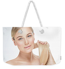 Gentle Female Combing Her Hair Weekender Tote Bag