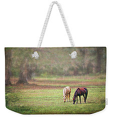 Weekender Tote Bag featuring the photograph Gently Grazing by Lewis Mann