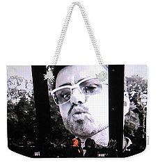 Weekender Tote Bag featuring the photograph George Michael Sends A Kiss by Toni Hopper