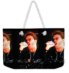 Weekender Tote Bag featuring the photograph George Michael The Passionate Performer by Toni Hopper