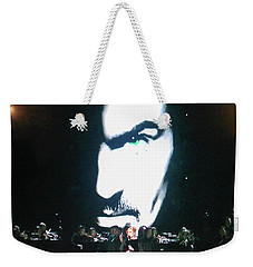 Weekender Tote Bag featuring the photograph George Michael's Eye Appeal by Toni Hopper