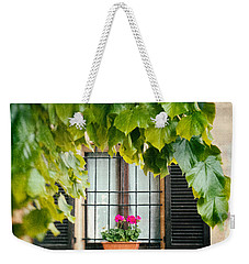 Weekender Tote Bag featuring the photograph Geraniums On Windowsill by Silvia Ganora