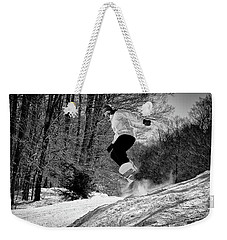 Weekender Tote Bag featuring the photograph Getting Air On The Snowboard by David Patterson