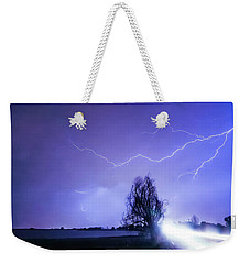 Weekender Tote Bag featuring the photograph Ghost Rider by James BO Insogna