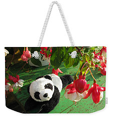 Weekender Tote Bag featuring the photograph Ginny Under The Red And White Fuchsia by Ausra Huntington nee Paulauskaite