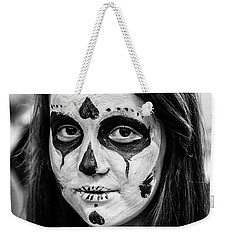 Weekender Tote Bag featuring the photograph Girl In Skull Facepaint by John Williams