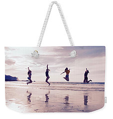 Girls Jumping On Lofoten Beach Weekender Tote Bag by Tamara Sushko