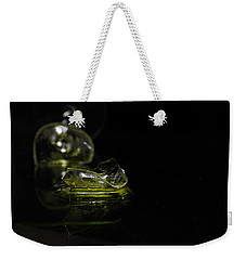 Weekender Tote Bag featuring the photograph Glass Shard by Susan Capuano