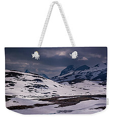 Weekender Tote Bag featuring the photograph Gloomy Day On The Snow Road by Dmytro Korol