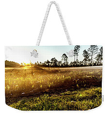 Weekender Tote Bag featuring the photograph Glow by Eric Christopher Jackson