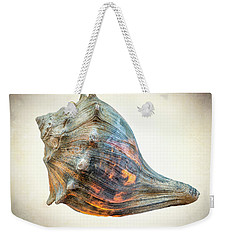 Weekender Tote Bag featuring the photograph Glowing Conch Shell by Gary Slawsky