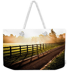 Weekender Tote Bag featuring the photograph Glowing Fog At Sunrise by Shelby Young