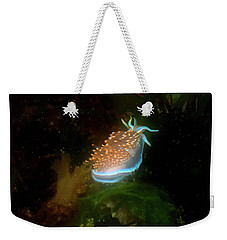 Weekender Tote Bag featuring the photograph Glowing Nudibranch by Adria Trail