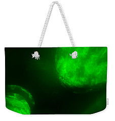 Weekender Tote Bag featuring the photograph Glowing Orbs by Greg Collins