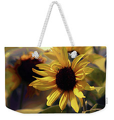Weekender Tote Bag featuring the photograph Glowing Sun by John Rivera