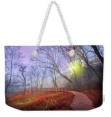 Weekender Tote Bag featuring the photograph Glowing Through The Trees by Debra and Dave Vanderlaan