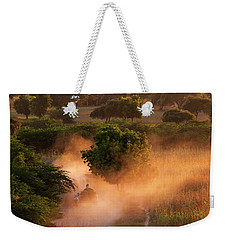Weekender Tote Bag featuring the photograph Going Home At Sunset by Pradeep Raja Prints